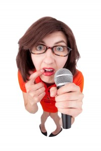 Woman-with-stage-fright-holding-mic-200x300