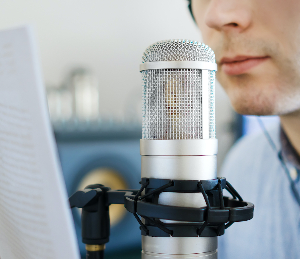 The voice acting payment riddle and how to solve it: image of voice actor reading a script