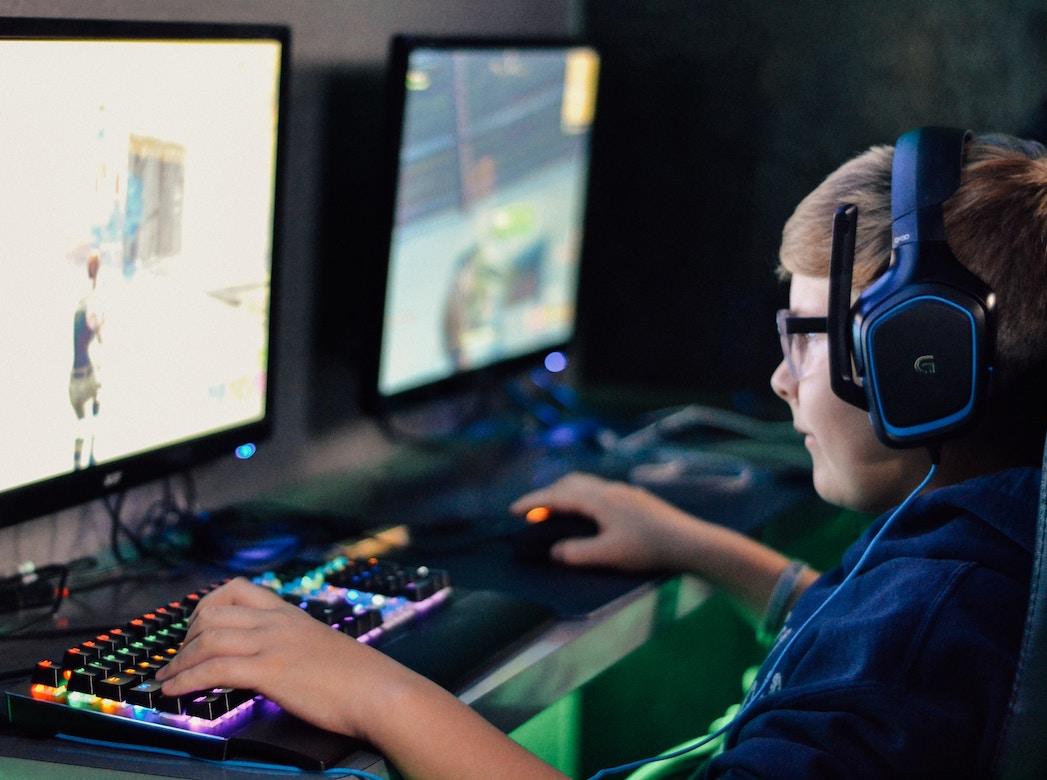 image of boy facing screen playing game