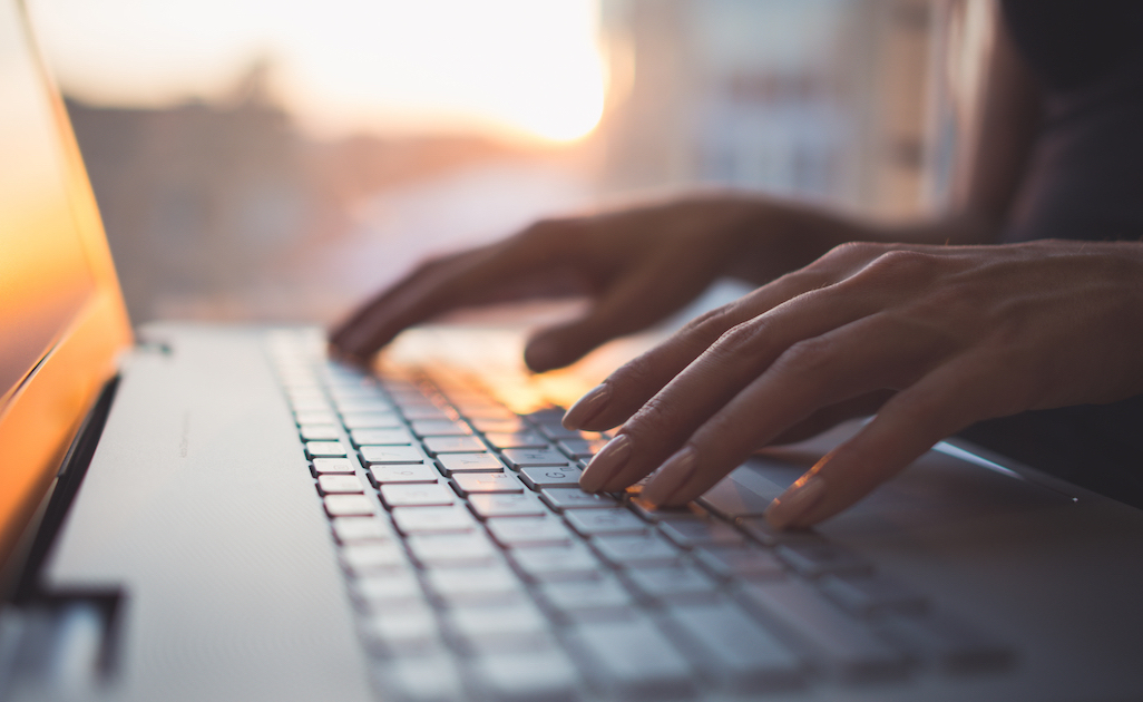 How to write commercial scripts: image of hands on a laptop keyboard