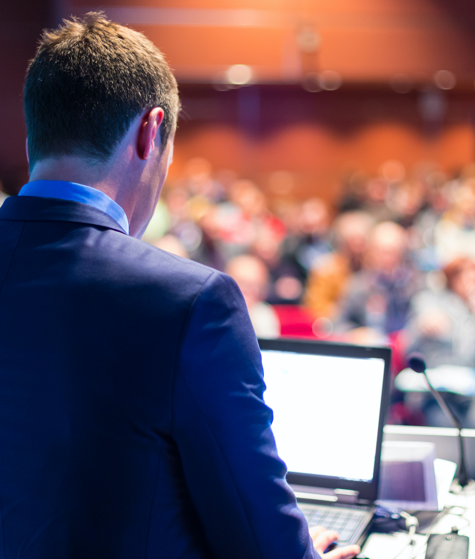 Image of man giving a business presentation