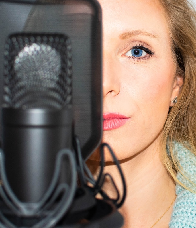 woman standing in front of a microphone