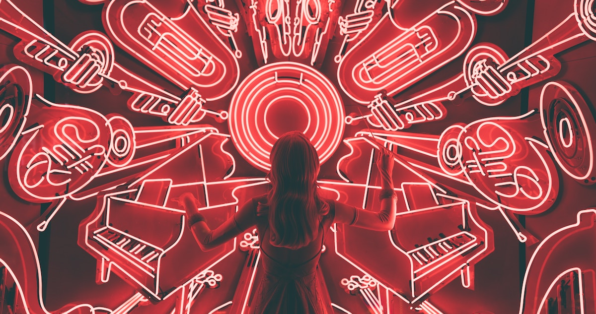 Royalty-free music: image of a girl standing in front of of a video screen showing musical instruments