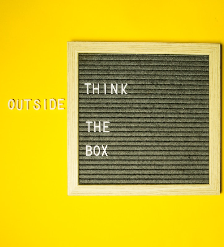 creative thinking: letters on a board saying 'think outside the box