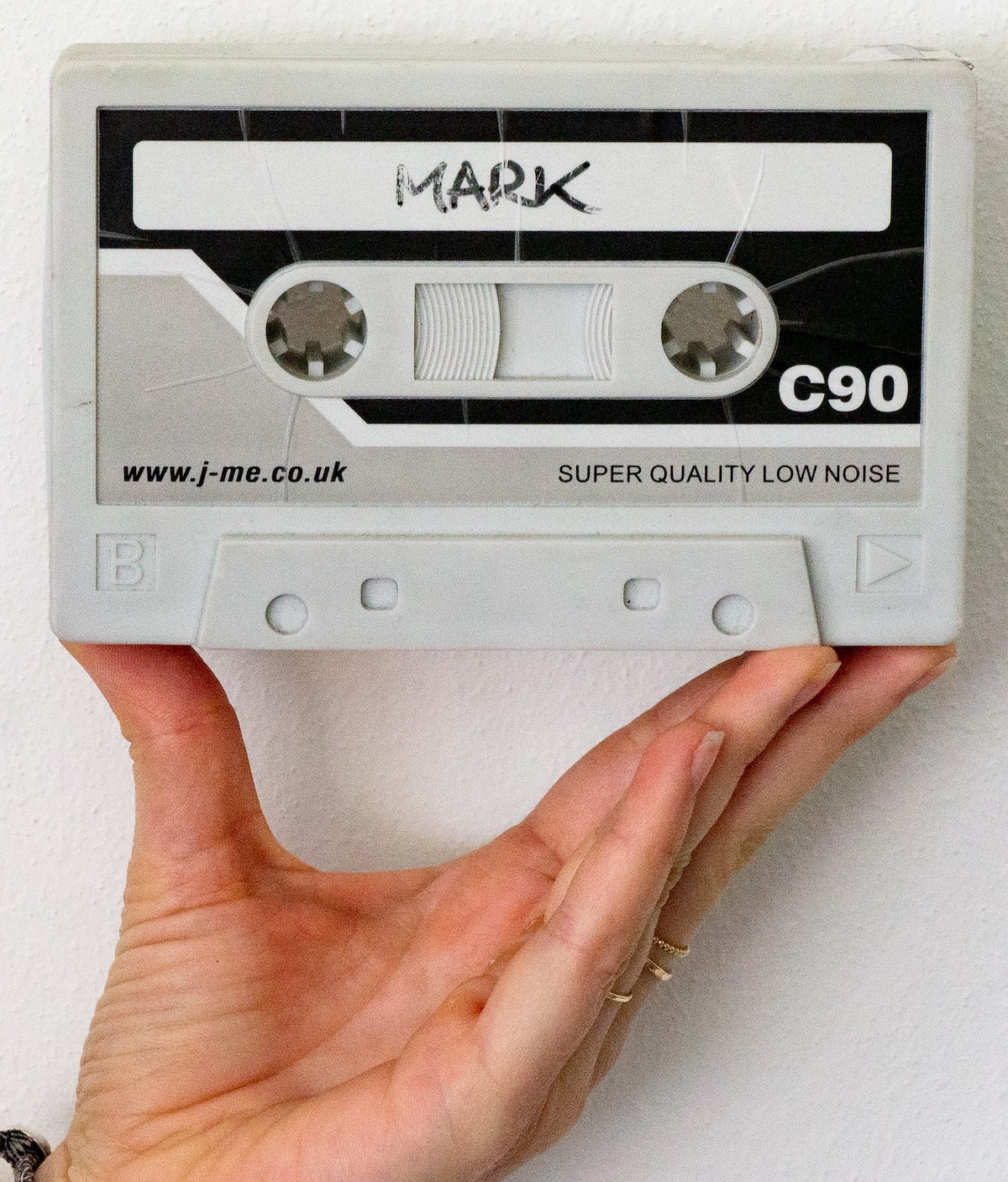 Judging a voice actor's demo: hand holding compact cassette