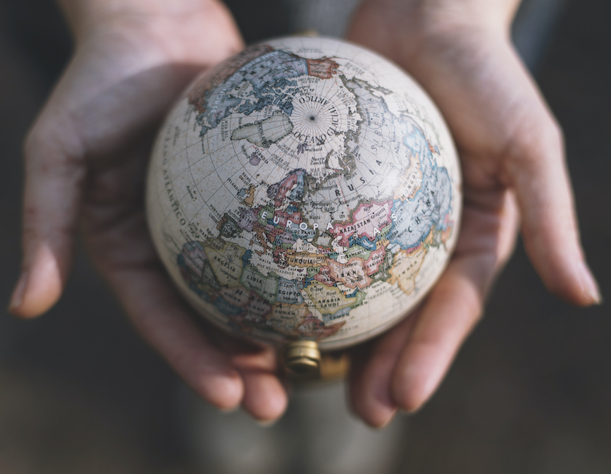 Hiring voice actors: image of hands holding a globe