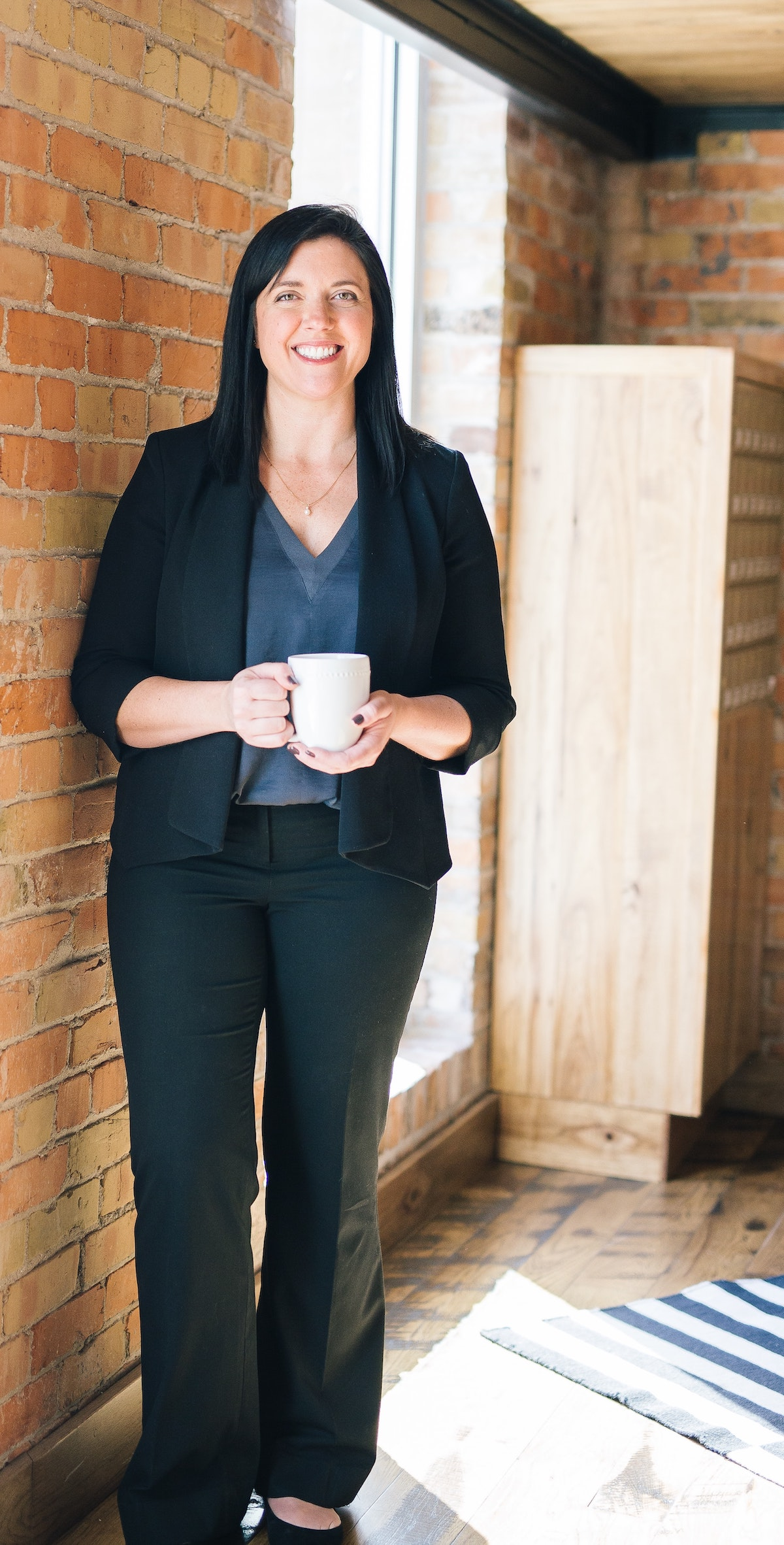 Why you should hire a professional voice actor: image of woman standing with a cup of coffee