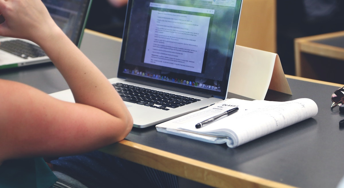 Promote your business: image of a man sitting in front of his computer