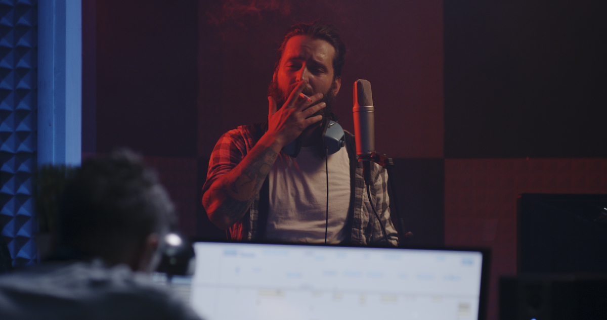 Why you should hire a professional voice actor: image of a voice actor in a studio