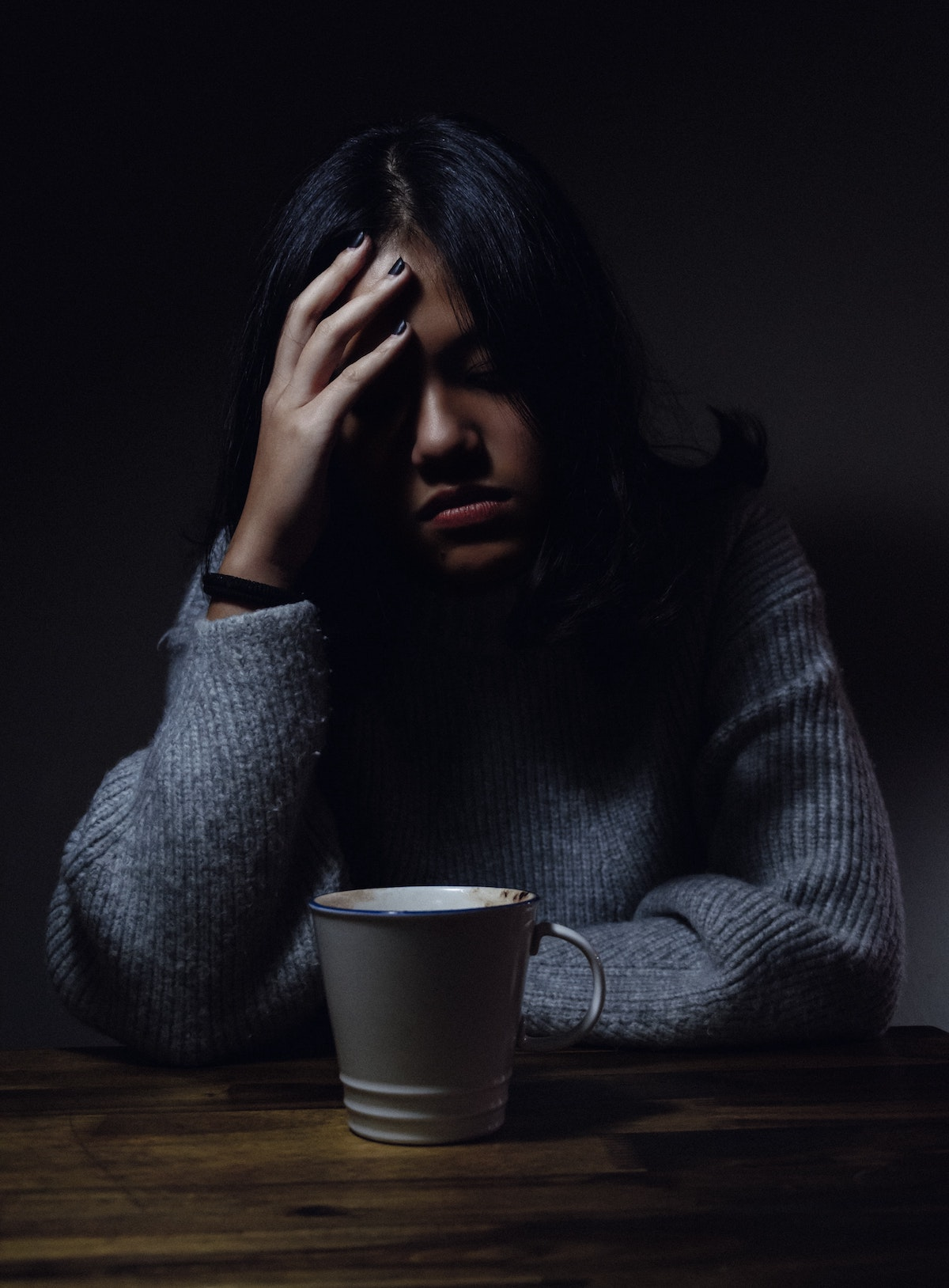 girl at a table with a cup of coffee