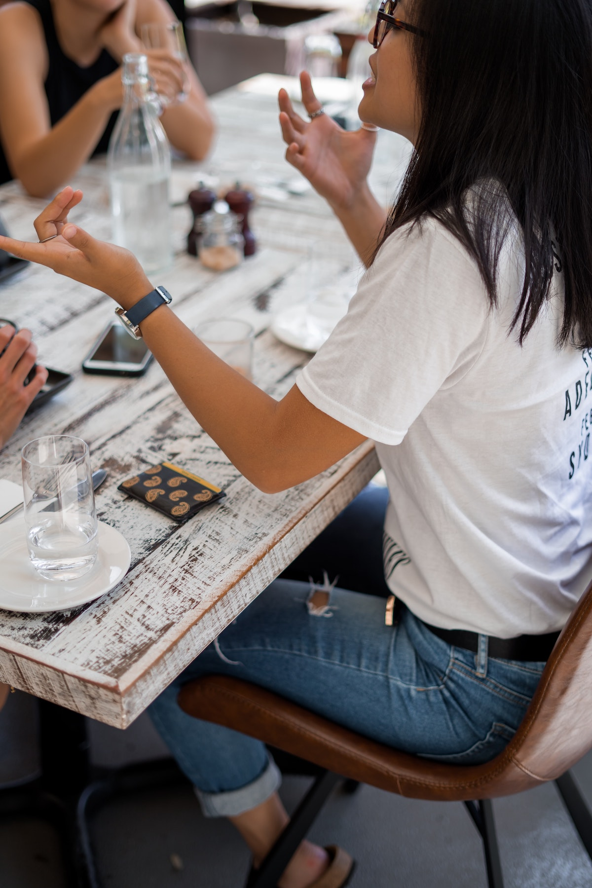 power of a voice over: people chatting across a table
