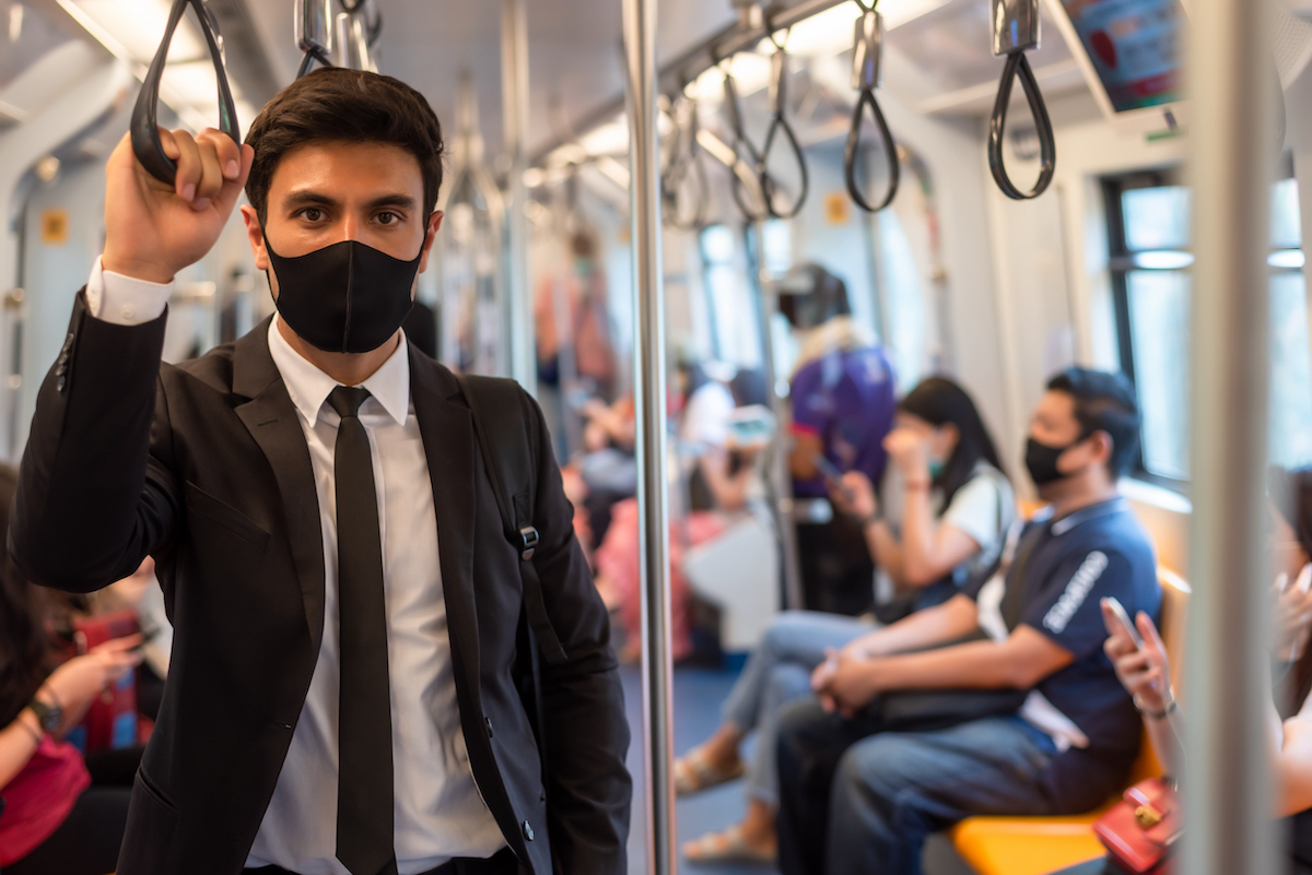 7 great things 2020 has taught us: image of man on subway wearing mask