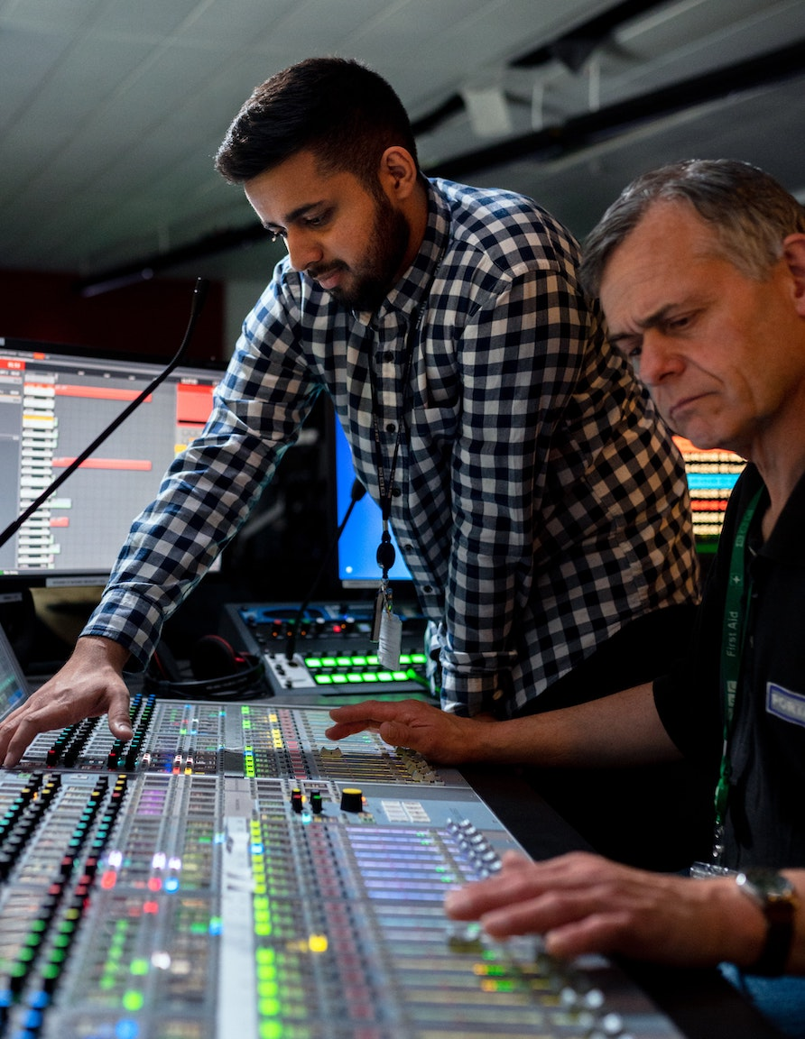 Cheap voice overs: producer and sound engineer at the mixing desk