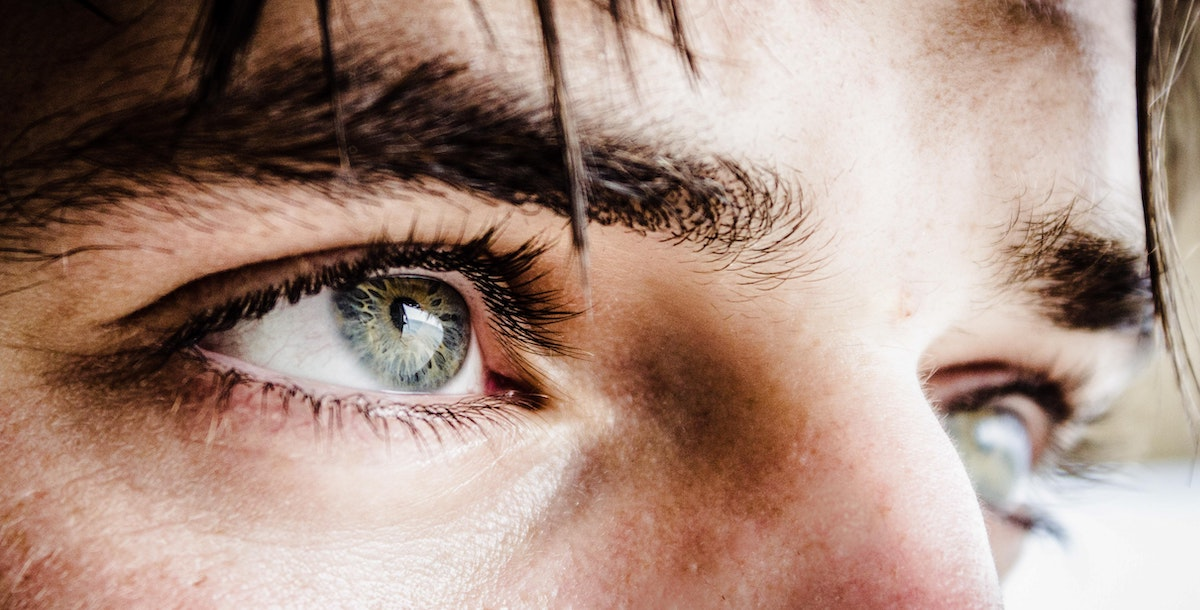 look after your eyes: image of young man staring into the distance