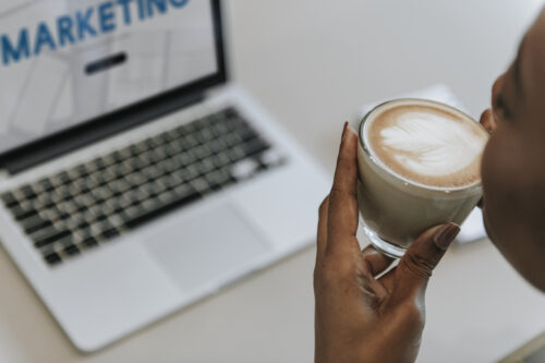Emotional Marketing Value: image of woman sipping coffee in front of a laptop