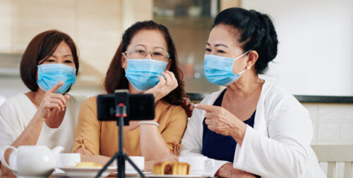 Greatest podcast in 2021: image of 3 Asian women podcasting wearing masks