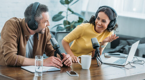 Podcast in 2021: image of a man and a woman podcasting