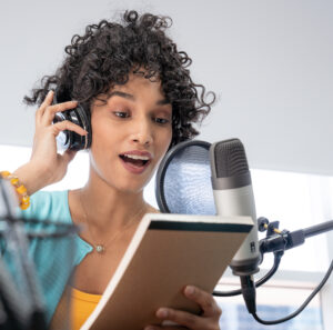 Podcast in 2021: image of young black woman storytelling in front of a microphone