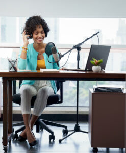 Podcast at your best: image of woman podcasting