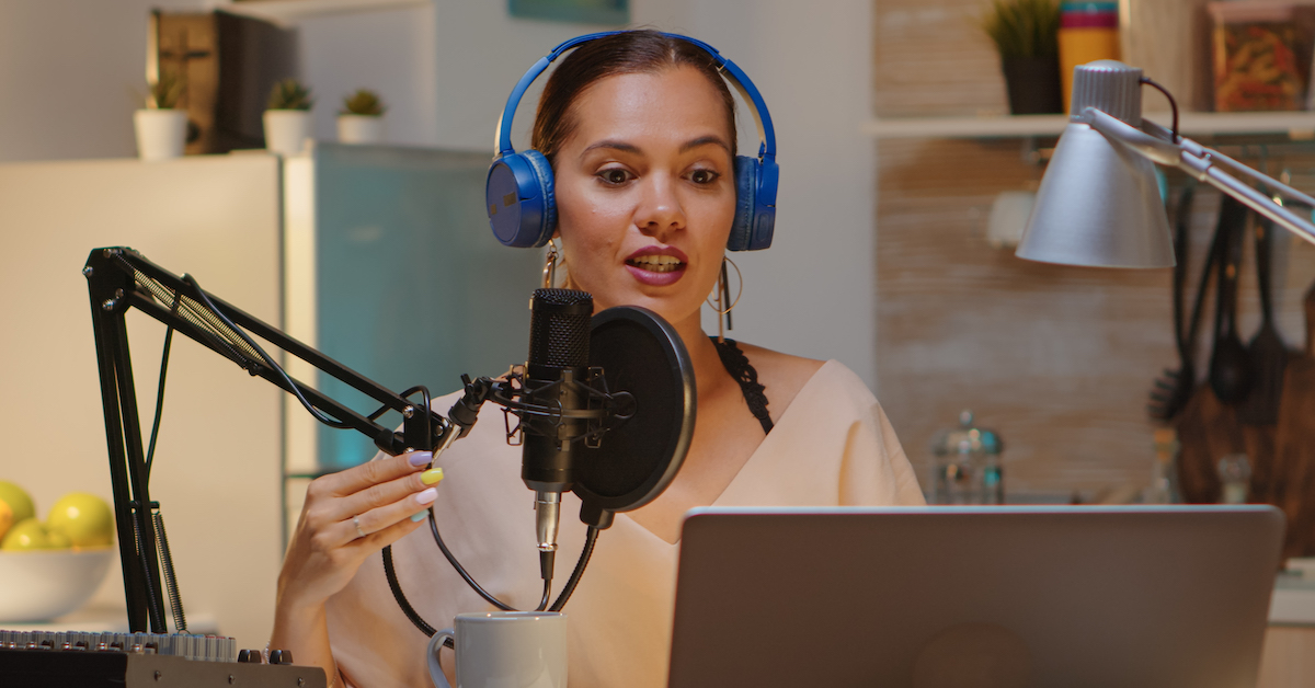 Market your podcast: image of woman podcasting
