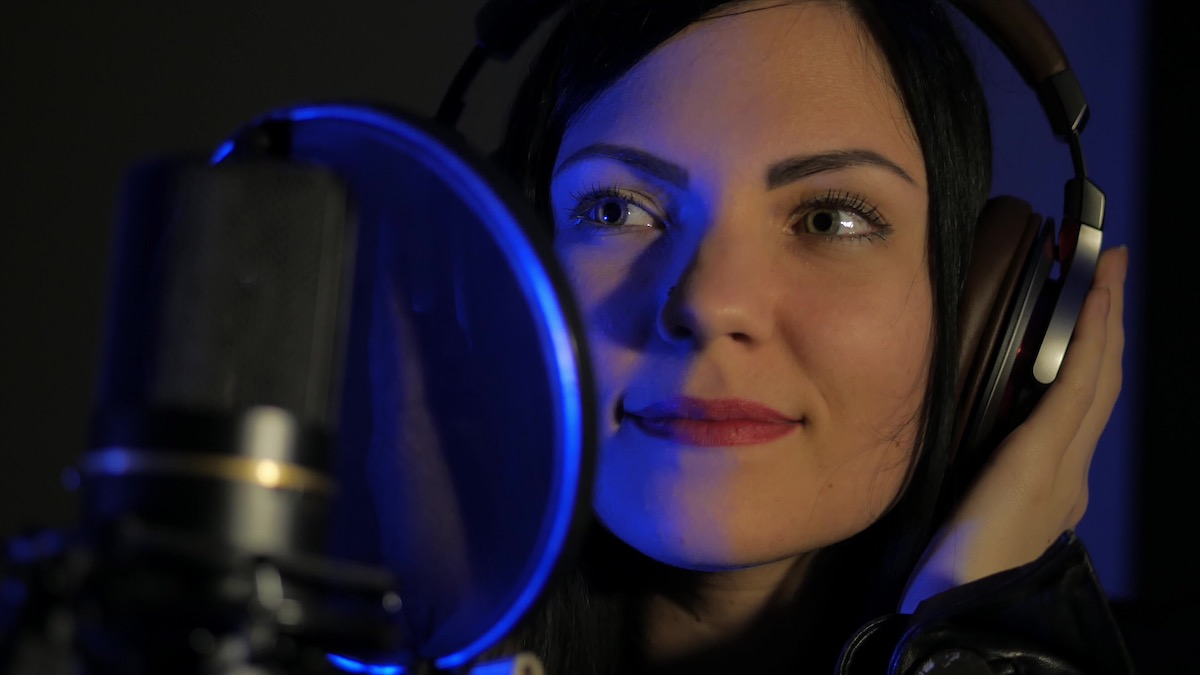 More than just a great voice: image of a voice actor behind a mic
