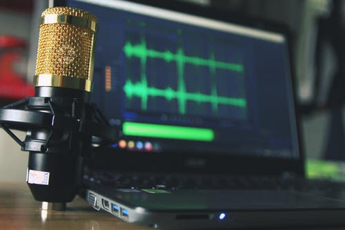 Video marketing strategy: image of a mic and a laptop