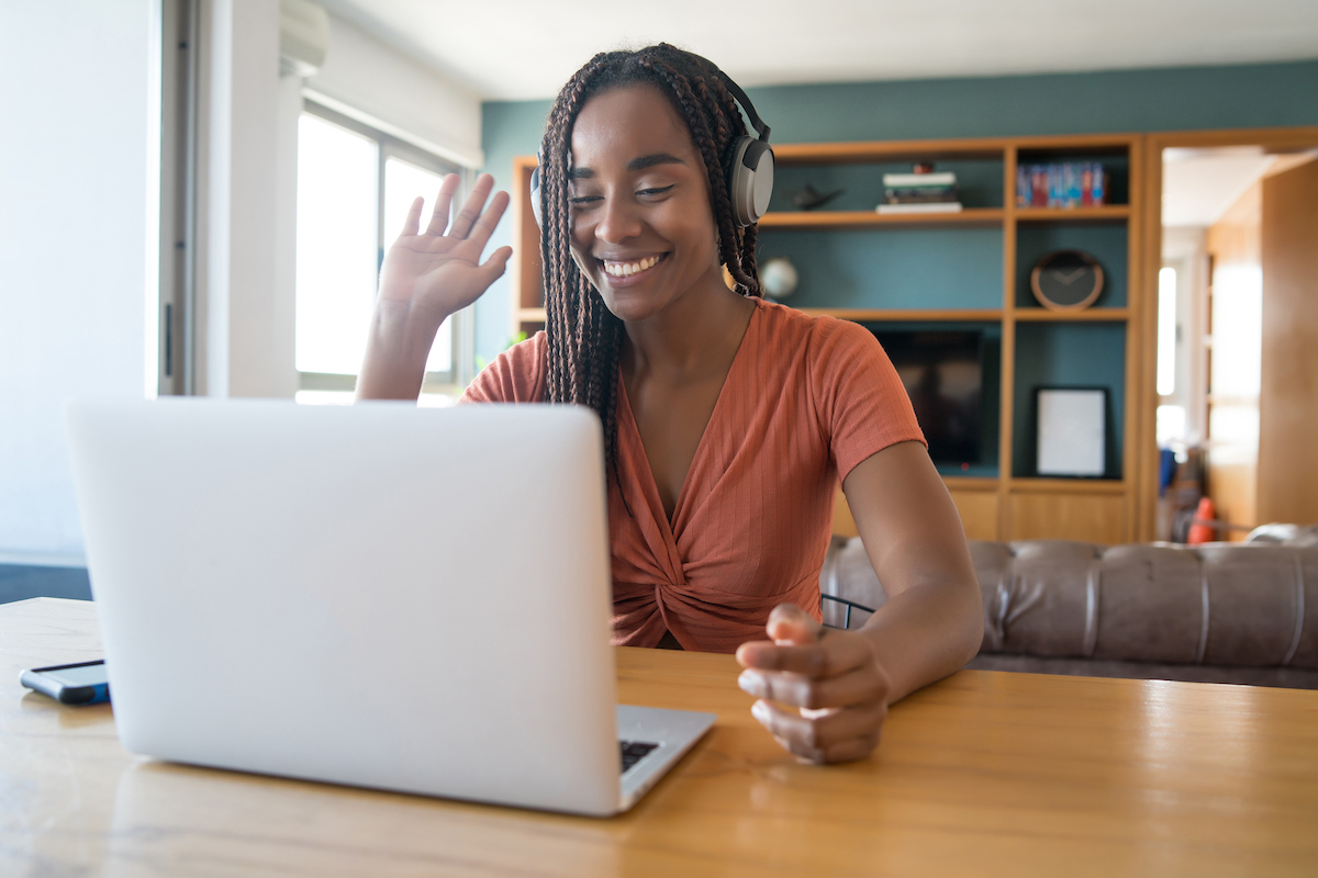 Woman in front of a laptop working from home.