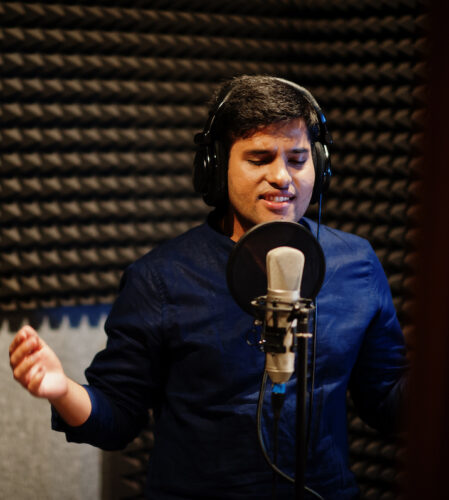 Localization: Indian voice actor in front of a mic