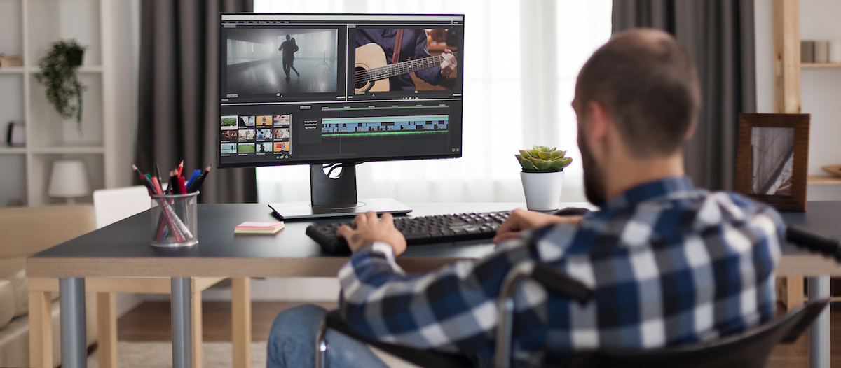 Marketing your business: image of a man editing a video