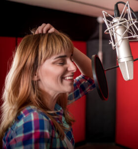 Engaging voice over: Image of smiling voice actor