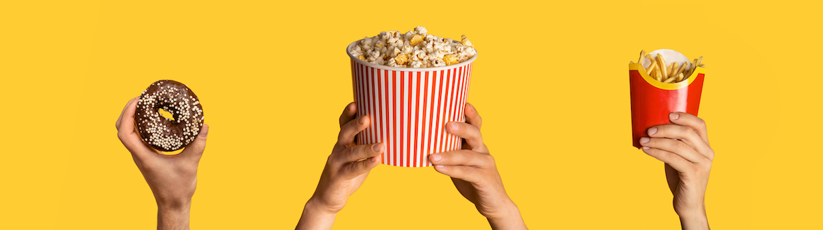 Localization: image of hands holding a donut, fries and popcorn