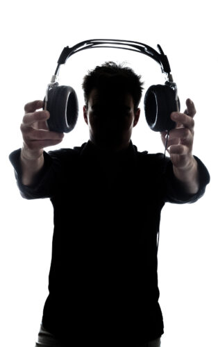 Writing to be heard: image of a man holding headphones