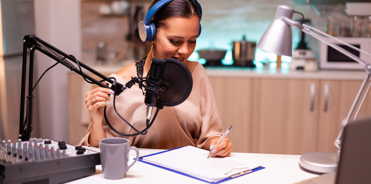 Writing to be heard: image of a woman wearing headphones and writing