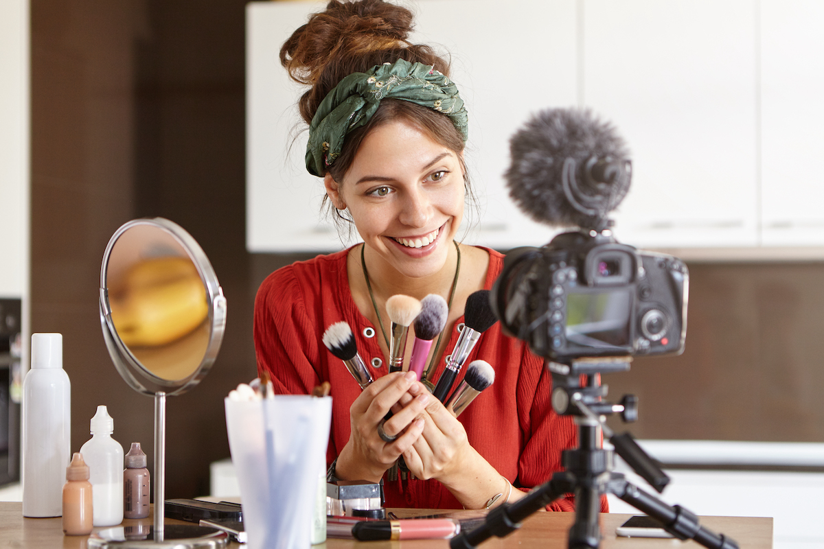 Marketing your business: image of a woman presenting a makeup video in front of a camera
