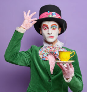 Engaging voice over: image of a clown holding a teacup