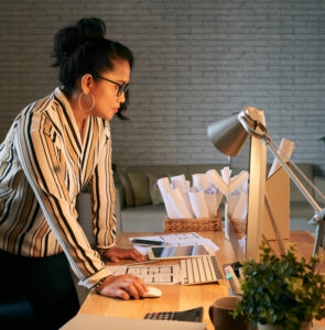 Email marketing: image of a woman standing in front of her desktop computer