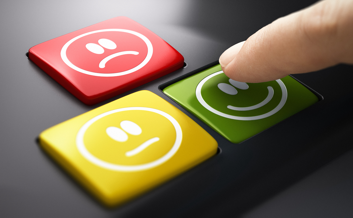Customer experience: image of emoji buttons with a finger hovering over the green smiley button