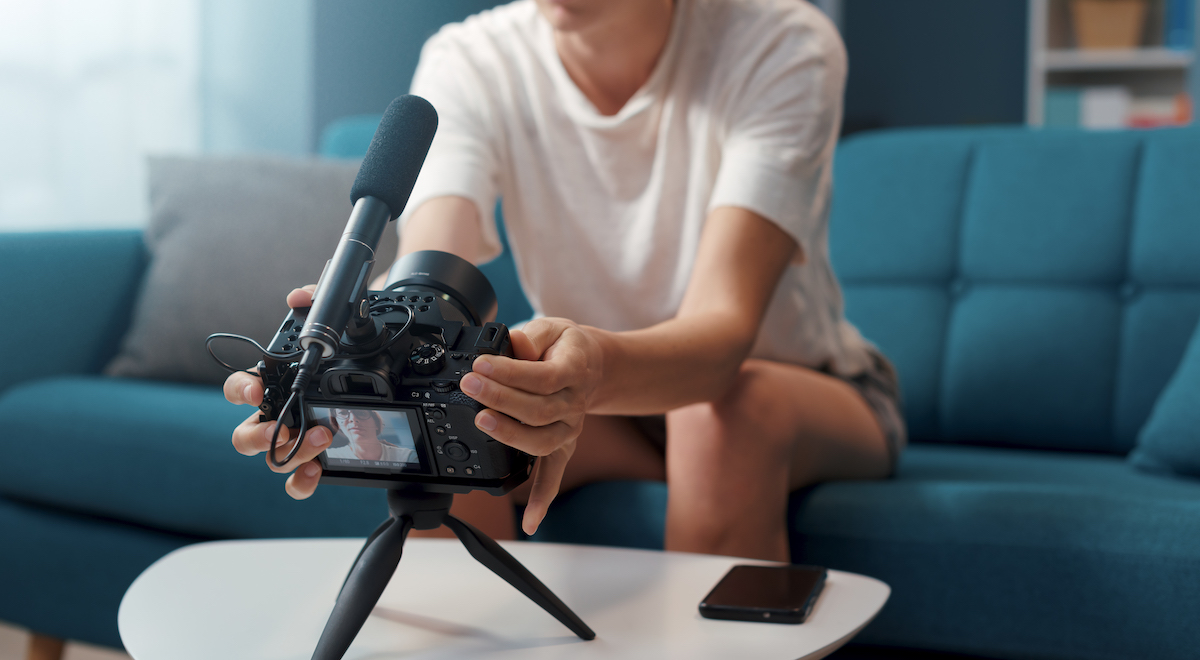 Make your business stand out: image of blogger setting up a camera for a video recording