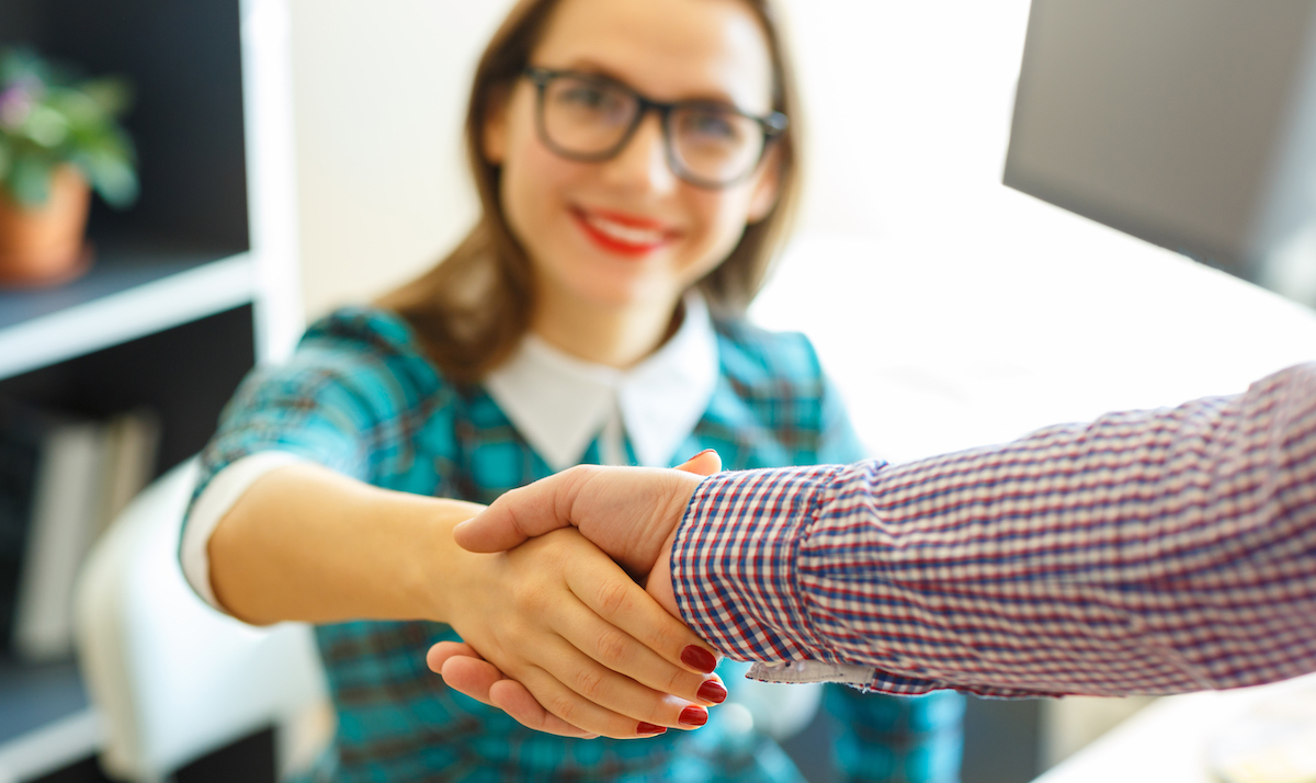 Affiliate marketing: image of a man and woman shaking hands